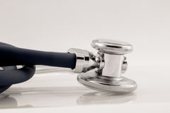 Studio shot of stethoscope detail with reflection Royalty Free Stock Photo