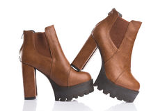 Studio shot of stylish brown autumn boots Stock Images