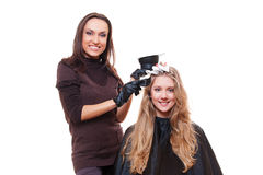 Studio shot of stylist with client Stock Images