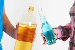 Studio Shot Of Teenage Couple Drinking Alcohol. Close Up Of Teenage Couple Drinking Alcohol Stock Images