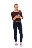 Studio Shot Of Teenage Girl Sending Text Message Stock Photos