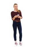 Studio Shot Of Teenage Girl Sending Text Message Stock Images