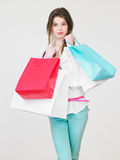 Studio Shot Of Teenage Girl With Shopping Bags Royalty Free Stock Photos