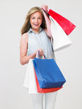 Studio Shot Of Teenage Girl With Shopping Bags Stock Images