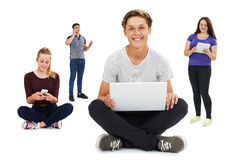 Studio Shot Of Teenagers Using Communication Technology Stock Photo