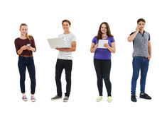Studio Shot Of Teenagers Using Communication Technology Royalty Free Stock Image