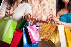 Group Of Young People Enjoying Their Shopping Spree. Studio shot of three young people enjoying a sale event Royalty Free Stock Image