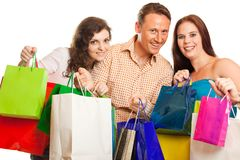 Group Of Young People Enjoying Their Shopping Spree. Studio shot of three young people enjoying a sale event Stock Photo