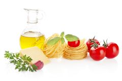 Studio shot of tomatoes,pasta,basil and cheese on white Stock Images