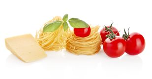 Studio shot of tomatoes,tagliatelle,basil and cheese on white Royalty Free Stock Photography