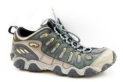 Close-up brand new male hiking shoes on white stock photo