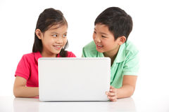 Studio Shot Of Two Chinese Children With Laptop Royalty Free Stock Photography