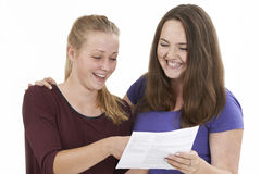 Studio Shot Of Two Female Teenage Friends Celebrating Exam Resul Stock Image