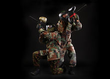 Studio shot of two paintball players Stock Photos