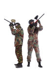Studio shot of two paintball players Stock Photo