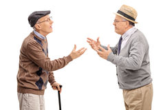 Studio shot of two senior gentlemen arguing Royalty Free Stock Photo