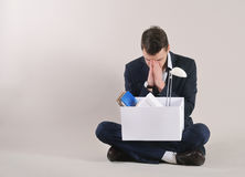Studio shot of very sad and tired businessman with office stuff Stock Photos