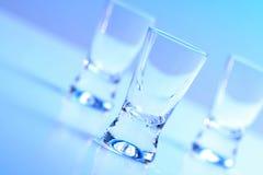 Studio shot of vodka glasses Stock Images