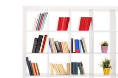 Studio shot of a white wooden bookshelf royalty free stock photo