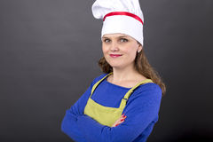 Studio shot of a woman with cook hat holding arms crossed Royalty Free Stock Photo