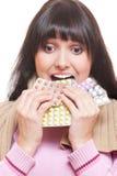 Studio shot of woman eating pills royalty free stock photography