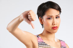 Studio Shot Of Woman Giving Thumbs Down Gesture Stock Image