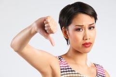 Studio Shot Of Woman Giving Thumbs Down Gesture Stock Image