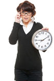 Studio shot of woman in glasses with clock Stock Images