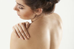 Studio Shot Of Woman With Painful Shoulder Stock Photos