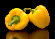 Studio shot of yellow bell peppers isolated on black Stock Images