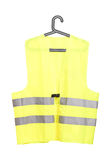 A studio shot of a yellow vest on a hanger. Isolated on white background Stock Photos