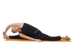 Studio shot of yoga instructor, isolated on white Stock Photo