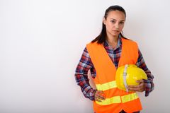 Studio shot of young Asian woman construction worker holding har royalty free stock photos