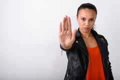 Studio shot of young Asian woman showing stop hand sign while we royalty free stock image
