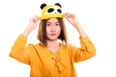 Studio shot of young beautiful Asian woman holding hat with both. Hands stock image
