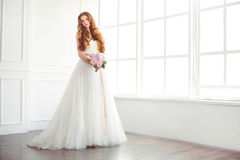 Studio shot of young beautiful bride. Wedding fashion bride with bouquet in hands Royalty Free Stock Images