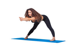 Studio shot of a young fit woman doing yoga Stock Image