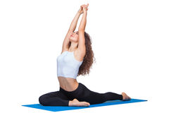 Studio shot of a young fit woman doing yoga Royalty Free Stock Photo