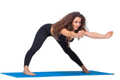Studio shot of a young fit woman doing yoga Stock Photos