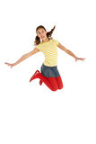Studio Shot Of Young Girl Jumping In Air stock photo
