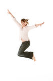 Studio Shot Of Young Girl Jumping In Studio Royalty Free Stock Images