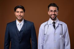 Studio shot of young handsome Iranian brothers together against royalty free stock images