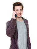 Studio shot of a young handsome man at the phone Stock Images