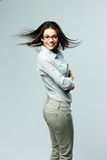 Studio shot of a young happy woman standing Stock Photo