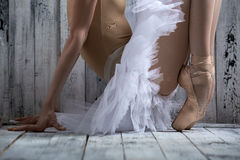 Studio shot, young legs graceful ballerina Royalty Free Stock Photography