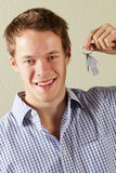 Studio Shot Of Young Man Holding Keys Stock Photo