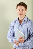 Studio Shot Of Young Man Holding Tablet Computer Stock Photos