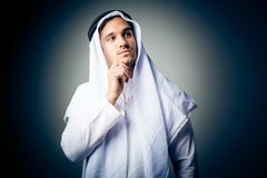 Young Man Wearing Traditional Arabic Clothing. Studio shot of young man wearing traditional arabic clothing Royalty Free Stock Images