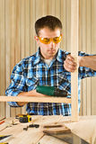 Young men works with screwdriver Royalty Free Stock Photos