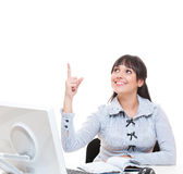 Studio shot of young secretary pointing up Stock Photography